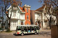 New vehicles-minibuses of the Municipality of the Princes's Islands used instead of the horse carts for the public transport in front of the old woode...