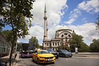 View to the Dolmabahce Mosque in Kabatas district on Bosphorus, Istanbul, Turkey, Europe.