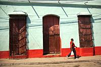 Man in front of the colonial building at the town center, Trinidad, Sancti Spiritu Province, Cuba, West Indies, Central America.
