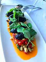 Beans with black pudding, red pepper and water cress. Spain.