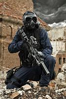 Post apocalypse. Sole survivor in tatters and gas mask on the ruins of the destroyed city.