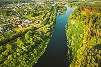 Aerial View Of Calm River And Village In Belarus, Europe. Green Forest Woods Landscape In Sunny Summer Evening. Top View Of Beautiful European Nature ...
