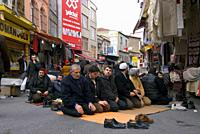 Traveling around Istanbul. Faithful called to prayer on a street in Istanbul.