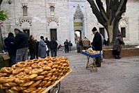 Traveling around Istanbul. Turkish donut stall called Simit at an open-air flea market in Beyazit Square.