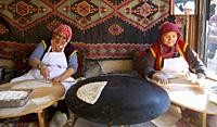 Traveling around Istanbul. Two Turkish women preparing a typical Turkish dish called Gözleme, which are a kind of pancakes.