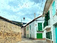 Luna street viewed through a wet glass. Lozoya, Madrid province, Spain.