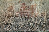 Carving of King being carried on litter by soldiers going to war, Angkor Wat temple, Siem Riep, Cambodia.