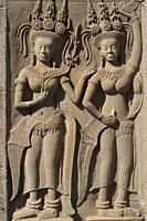 Carvings of pair of apsara dancers, Angkor Wat temple, Siem Riep, Cambodia.