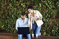 Young couple outdoor working with laptop and tablet