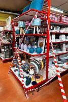 During the COVID confinement in France a general purpose store has sections cordoned off as not for sale if they competed with a single purpose enterp...