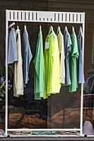 Stockholm, Sweden A rack of T-shirts in a store window.