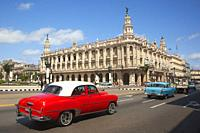 Old American cars in front of the Great Theatre-Gran Teatro in Center Havana, La Habana, Cuba, West Indies, Central America.