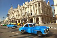 Old American cars and coco taxis in front of the Great Theatre-Gran Teatro and Hotel Inglaterra in Center Havana, La Habana, Cuba, West Indies, Centra...