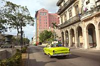 Old American car used as taxi in front of the colonial buildings at Paseo Del Prado at Old Havana , La Habana, Cuba, West Indies, Central America.