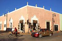 Tourists in front of the colonial buildings in the historic center, Valladolid, Yucatan Province, Mexico, Central America.
