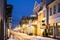 Parnu, Estonia. Night View Of Famous Ruutli Street With Old Buildings, Restaurants, Cafe, Hotels And Shops In Festive Evening Night Christmas Xmas New...