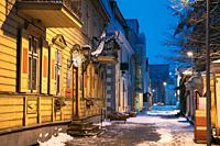 Parnu, Estonia. Night View Of Hospidali Street With Old Buildings And Houses In Evening Night Illuminations.