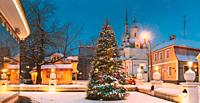Parnu, Estonia - December 15, 2017: Christmas Tree In Holiday New Year Festive Illumination And St. Katherine Orthodox Church. Panorama.