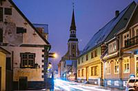 Parnu, Estonia. Night View Of Kuninga Street With Old Houses, Restaurants, Cafe, Hotels And Shops In Evening Night Illuminations. View Of Lutheran Chu...