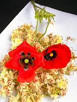 Two red poppies on white background.