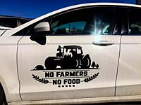 A logo used by farmers in India to protest against government policies displayed on a car in Canada, in support. This and similar graphics are appear...