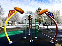 A modernistic playground in snow, Ontario, Canada. In warm weather, water will spurt and squirt out of these shapes, cascading down on playful childr...