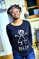 Young african woman with an cool hair style and a t-shirt posing outdoor.