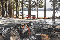 Fire pit and frozon lake. Lake of the Woods from Lake of the Woods Resort in Southern Oregon.