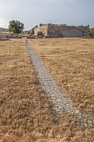 Hijovejo archaeological site. Entry footpath. Fortified roman enclosure on top granite scree. Quintana de la Serena, Extremadura, Spain.