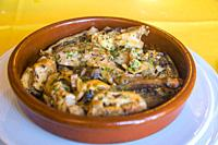 Grilled rabbit with garlic. Spain.
