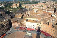 Siena from Campanile del mangia, city of Siena, Piazza del Campo, Fountain of Gaia,. roofs, Basilica San Domenico.