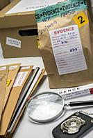 Files and evidence bag in a crime lab, conceptual image.
