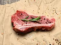 fresh raw piece of beef meat, striploin steak on a paper background, top view. Marbled piece of meat New York.