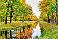 Tranquil autumn landscape with canal.