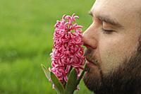 Smelling a hyacinth flower.