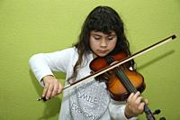 Little girl playing a violin.
