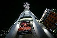 Sky City Tower. Night illumination against black background. Auckland, New Zealand.