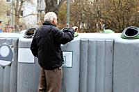Pensioner collecting deposit bottles to supplement income (Germany).