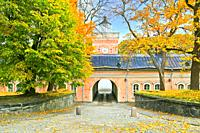 The pink building of Jetty Barracks, entrance to Iso Mustasaari, Suomenlinna, Finland on a day of autumn.