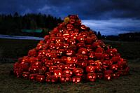 Large heap of glowing carved pumpkins in the night. Halloween Pumpkin event by Rannikko Market Garden. Halikko, Salo, Finland. October 16, 2020.