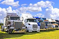 Classic conventional Kenworth, Volvo and Peterbilt trucks on display on Power Truck Show 2017. Alaharma, Finland. August 11, 2017.