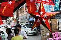 Yangon, Myanmar, Asia - A red star made of cardboard and little flags with the logo of the NLD party (National League for Democracy) are seen hanging ...