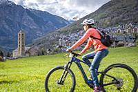 Woman on bike, Taüll, Vall de Boí, Lleida, Catalonia, Spain.
