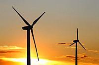 Symbol image: Wind turbines, wind farm at the sunrise.