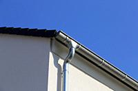 Roof gutter on a new tiled roof.