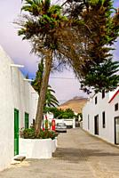 Travel impressions from Teguise, the former capital in the north of the Canary Island Lanzarote: Street scene with typical architecture, parked vehicl...