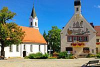 Spital church of the Holy Spirit and town hall with foundation scene, Bad Grönenbach in Allgäu, Bavaria, Germany.