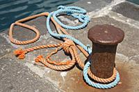 Mooring bollard and ropes.