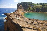 People sunbathing on the islet of Vila Franca do Campo off the coast of Sao Miguel, Azores islands, Portugal.
