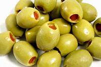 Closeup of stuffed green olives.